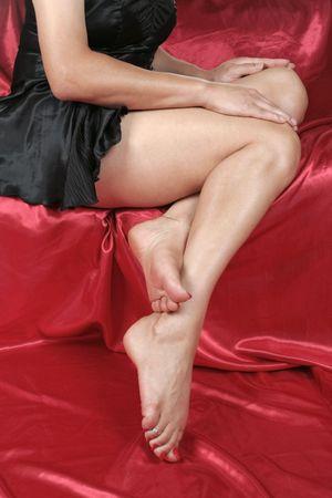 nightie: Woman legs with black nightie  isolated over white background