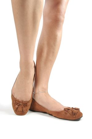 Woman legs with brown moccasin shoes over white Stock Photo - 6274755