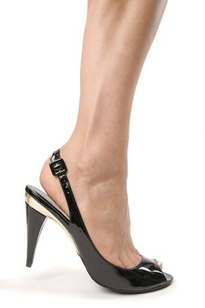 Woman legs with black high heel shoes over white Stock Photo - 6274756