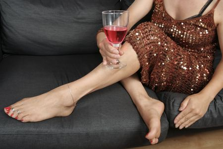 Beautiful woman  legs with wine drink relaxing photo