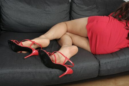 Beautiful woman  legs with  red dress relaxing photo
