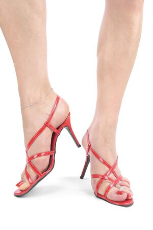 Woman legs with red  high heel shoes over white Stock Photo - 7942857