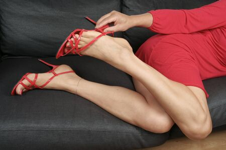 Beautiful woman  legs with short red dress relaxing photo