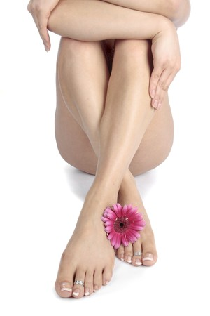 bare women: Woman legs and feet with flower isolated over white background