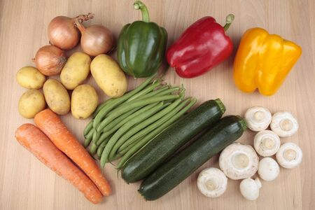 Mixed vegetables on wooden board photo