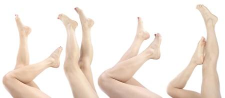 benen: Mooie vrouw benen en voeten geïsoleerd over Wit