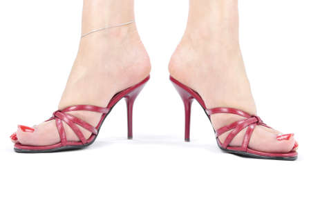 Woman legs with red high heel shoes over white Stock Photo - 8293759