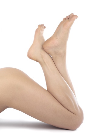 Woman legs isolated over white background photo