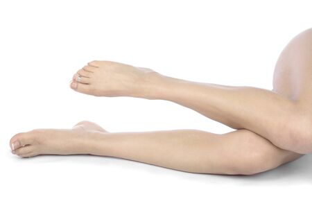 Woman legs and feet isolated over white background photo