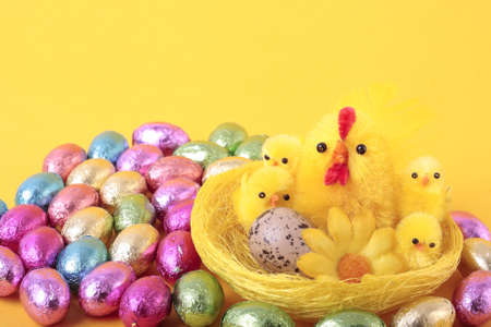 Easter eggs and  over yellow background photo
