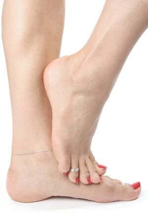 waxed legs: Woman feet and  legs isolated over white background Stock Photo