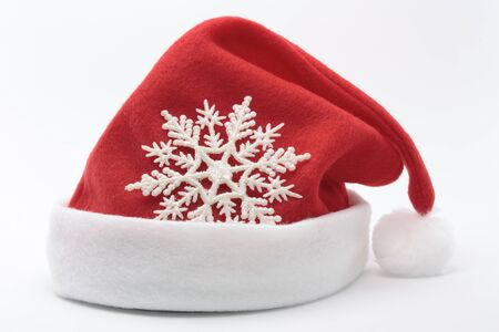 Christmas  santa hat decorations over white photo