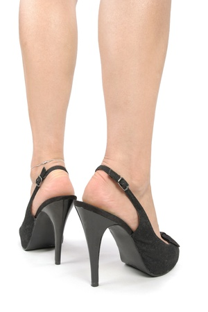 waxed legs: Woman legs with black high heel shoes over white