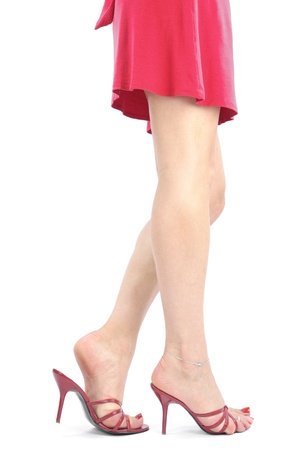 sandals: Beautiful woman  legs and feet with red dress over white backgroundf