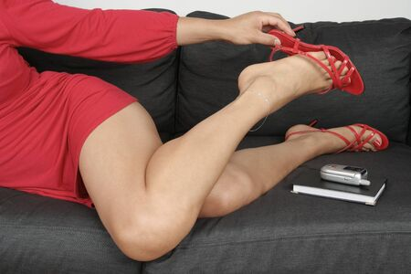 female feet: Beautiful woman  legs taking shoes off Stock Photo
