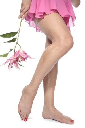 Woman legs with pink nightie and flowers  over white Stock Photo
