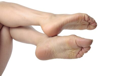 Woman feet   over white background photo