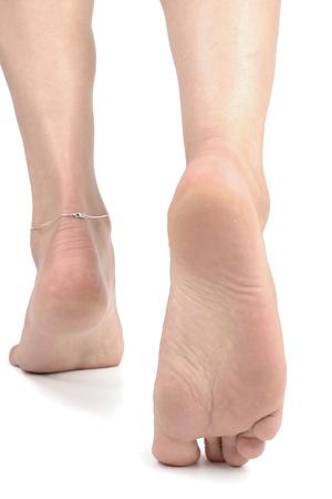 waxed legs: Piedi di donna over white