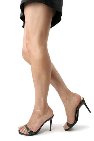 black heels: Beautiful woman  legs and feet with black heels over white