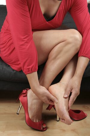 Beautiful woman  legs massaging aching  feet  relaxing Stock Photo