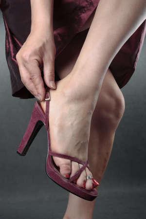 Beautiful woman feet putting on shoes Stock Photo - 8860166