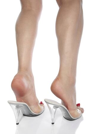 Beautiful woman legs and high heel shoes over white Stock Photo - 8860149