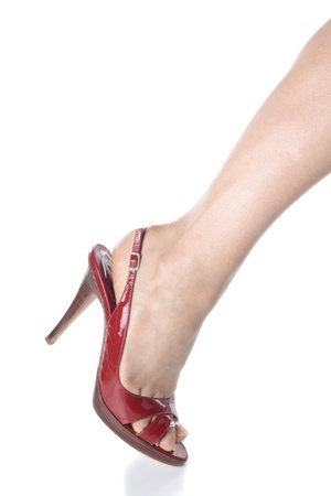 Beautiful woman legs and red heel shoes over white Stock Photo - 9003487