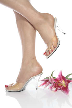 Beautiful woman feet and heel shoes over white Stock Photo - 9147072