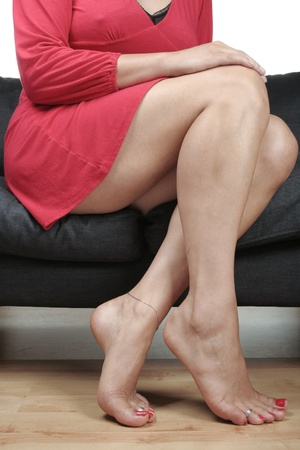 Beautiful woman  legs sitting