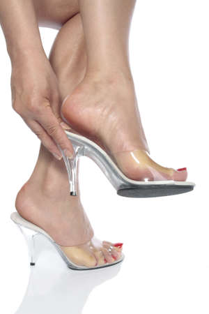 Beautiful woman feet and heel shoes over white Stock Photo - 9306887