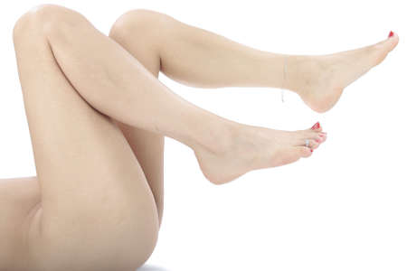female feet: Woman legs isolated over white Stock Photo