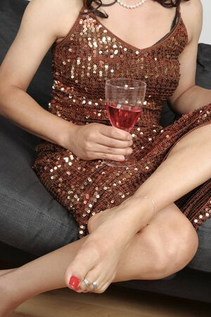 aching: Beautiful woman  legs with drink relaxing sitting