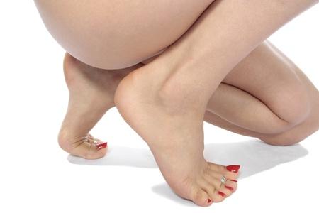 Woman legs isolated over white photo