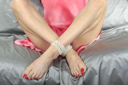 Beautiful woman  legs sitting relaxing photo