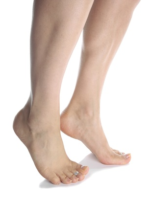 Woman feet isolated over white photo