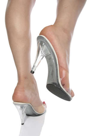 Beautiful woman feet and heel shoes over white Stock Photo - 9573896