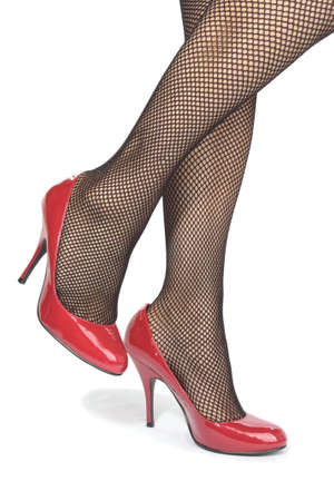 Beautiful woman  legs tights  with red  heels over white Stock Photo - 9573942