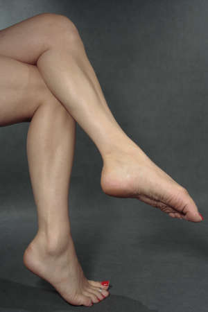 Woman feet  over grey background photo