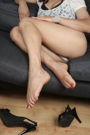 Beautiful woman  legs relaxing sitting Stock Photo