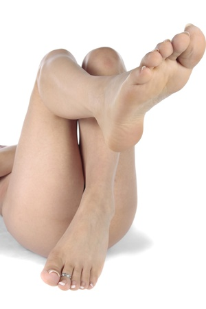waxed legs: Woman feet isolated over white Stock Photo