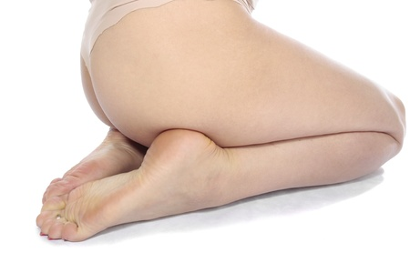 waxed: Woman feet legs isolated over white