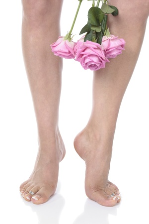 waxed legs: Woman  feet legs and flowers  over white
