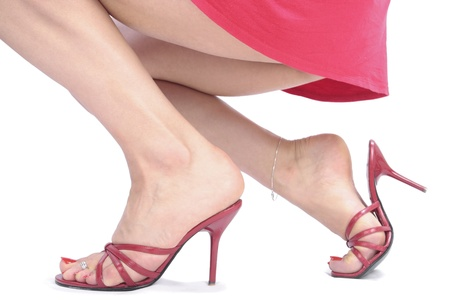 Woman legs  redheel shoes over white background Stock Photo - 10616616