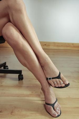 Woman legs   black heel shoes photo