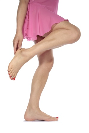 Woman legs with  dress  aching feet over white photo