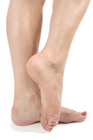 waxed legs: Donna piedi su sfondo bianco Archivio Fotografico