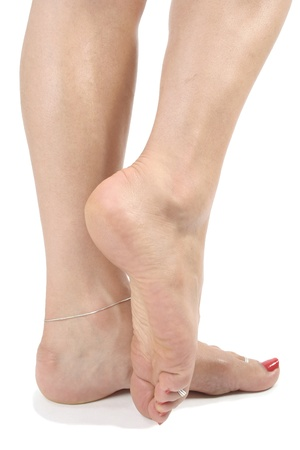 waxed legs: Woman  feet over white background
