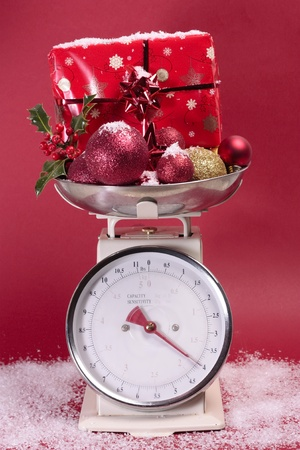 Christmas decorations on weighing sclaes cost concept Stock Photo - 11546396