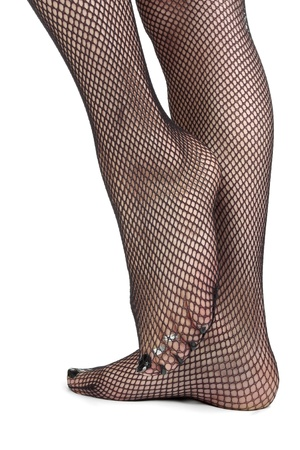 Womanfeet wearing fishnet tights  over white background photo
