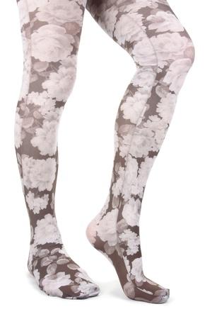 Frau Beine tragen florale Strumpfhose über weiße